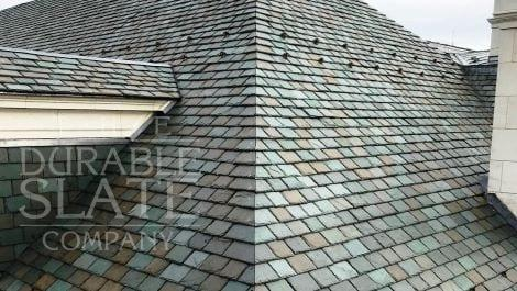 close-up of a repaired slate roof with snow guards