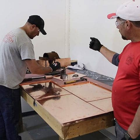 training a durable slate employee to construct a flat lock roof