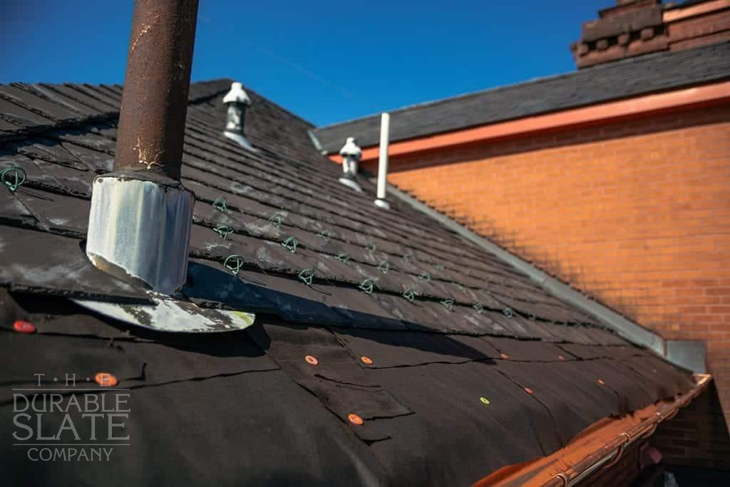 slate roof with rusted vent